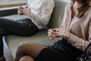 how to get a divorce in Australia - man and woman sitting on a couch in a law office - Melbourne Law Studio